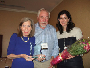 Photo of Carol Goar receiving the CMHA Ontario Media Award from outgoing provincial Board Chair Ron Wyborn and CMHA Ontario CEO Camille Quenneville