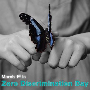 "Photo of a hand holding a butterfly with the words ""March 1 is Zero Discrimination Day"""