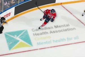 CMHA Logo on ice with hockey player