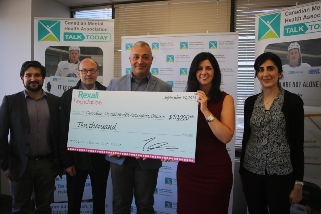 Rexall foundation donates $10,000 to support youth athlete mental health, holding cheque